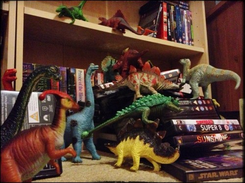 Eats Amazing -#dinovember day 9 - the dinosaurs cause chaos at the DVD shelf