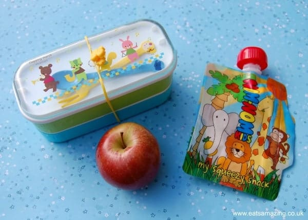 Eats Amazing - fill a small bento box with food then add extras like fruit and a pouch full of yoghurt to the lunch bag