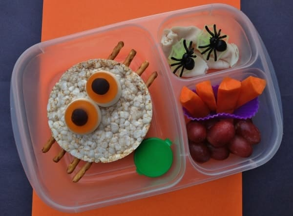 Simple Spider Themed Bento School Lunch for Halloween with giant rice cakes and pretel legs - Eats Amazing UK