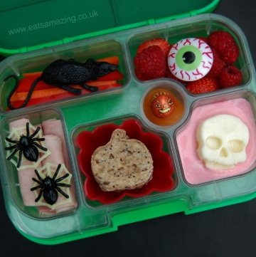 Simple Halloween Bento Packed Lunch in the Yumbox from Eats Amazing UK with Pumpkin Shaped Sandwiches and Frozen Yoghurt Skull