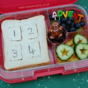 Eats Amazing UK - Yumbox Lunch for the first day of advent with an advent calendar sandwich - the flaps open to reveal little cheese cutouts for pictures below - cute and creative kids food