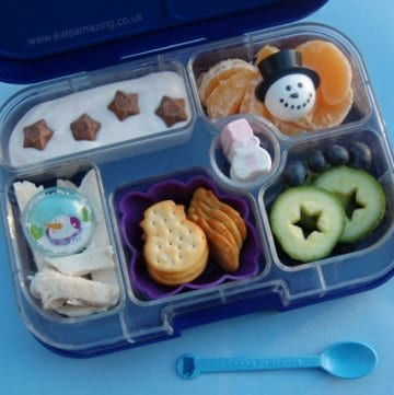Eats Amazing UK - Simple winter themed bento lunch idea packed in the Yumbox - bits and pieces are so easy to pack and look pretty - snowman, stars, yoghurt