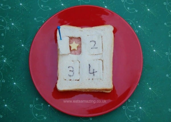 Eats Amazing UK - Special edible advent calendar sandwich for the first day of advent - the flaps open to reveal little cheese cutouts for pictures below