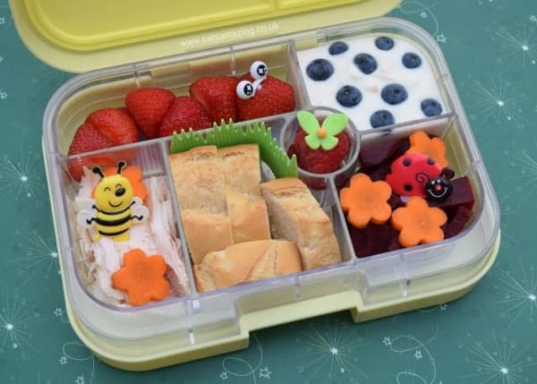 Garden themed bento box idea with cute strawberry caterpillar from Eats Amazing UK - healthy fun food for kids