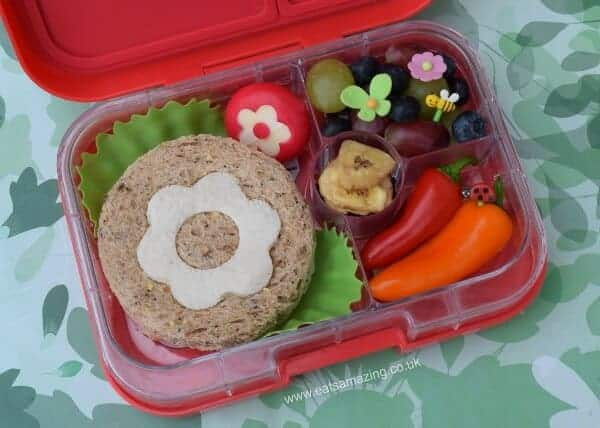 Garden bento lunch in the Yumbox UK panino bento box - fun healthy packed lunch ideas for kids - with cute flower sandwich