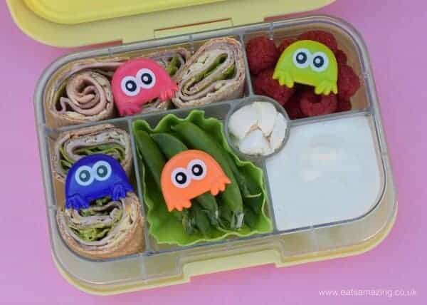 Simple tortilla wrap spirals kids lunch with cute monster cupcake rings in the Yumbox - bento box with compartments from Eats Amazing UK