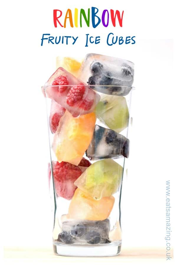 These rainbow fruit ice cubes are a fun way to get kids drinking water this summer - fab for party drinks and BBQs too #kidsfood #rainbowfood #icecubes #summerfood #drinkrecipes #partyfood #rainbow #frozen #healthykids #funfood