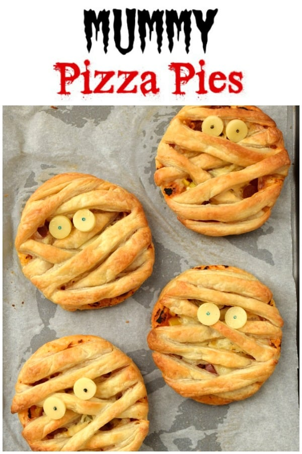Easy Mummy Puff Pastry Pizza Pies recipe - this fun Halloween food for kids is perfect for party food lunch boxes or a fun Halloween meal #EatsAmazing #Halloween #halloweenfoods #halloweenrecipes #partyfood #halloweenparty #pizza #pastry #mummy #funfood #foodart #kidsfood