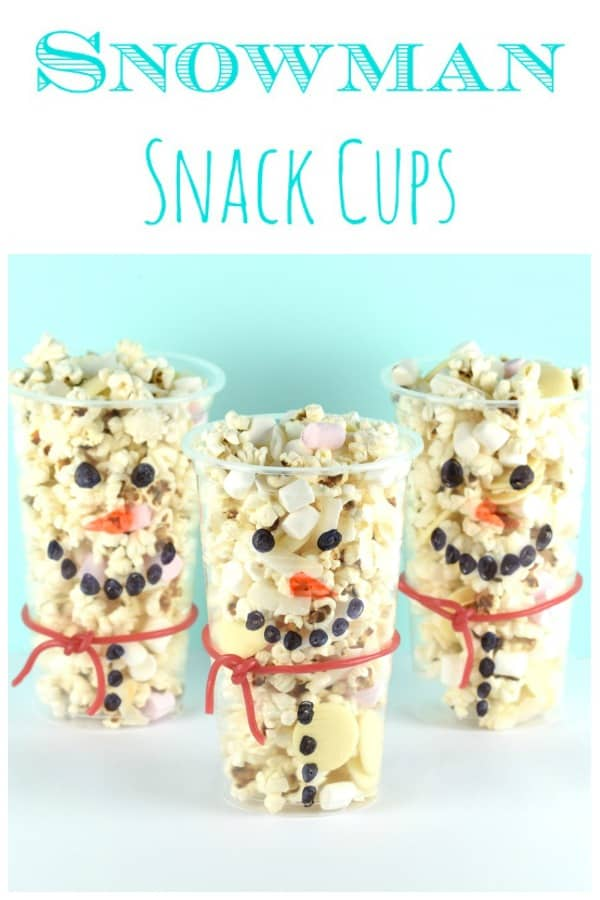 Cute and easy snowman snack cups recipe - this fun kids food idea is perfect for winter themed party food and Christmas movie night snacks #EatsAmazing #ChristmasFood #funfood #foodart #snowman #winter #Christmas  #snack #kidsfood #kidscrafts #popcorn #movienight #christmasparty