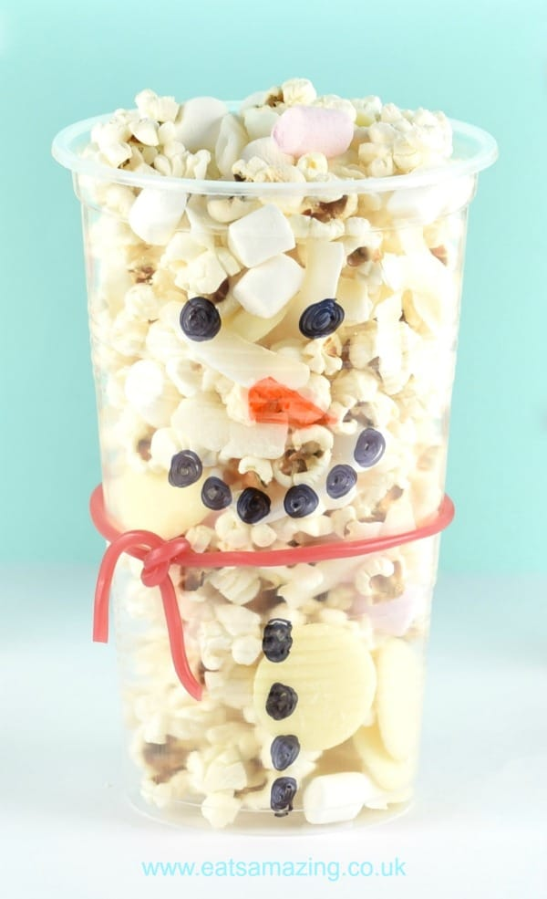 These cute and easy snowman snack cups are perfect for winter themed parties or a fun Christmas snack for kids