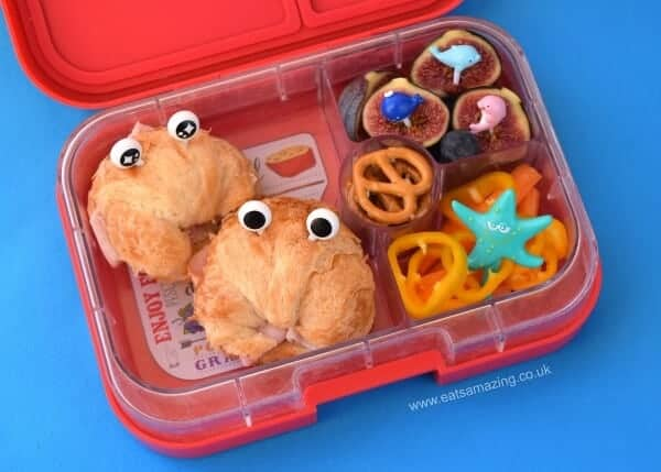 Mini Croissants make great crabs for under the sea themed food - fun kids school lunch idea in the Yumbox UK bento box from Eats Amazing UK