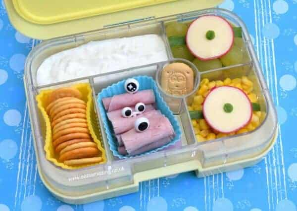 Minion themed lunch in the Yumbox UK Bento Box - fun food idea that kids will love from Eats Amazing