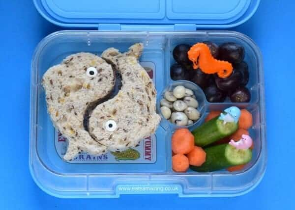 Easy ocean themed bento lunch in the Yumbox panino with lunch punch dolphin sandwiches - quick kids lunch idea from Eats Amazing UK