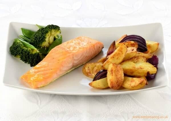 Quick and easy oven baked honey mustard salmon fillets recipe with homemade potato wedges - kid friendly meal idea from Eats Amazing UK