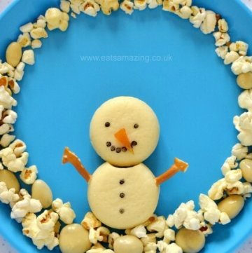 Cute and easy Snowman Snack Plate for Kids - part of the fun Christmas food advent calendar from Eats Amazing UK