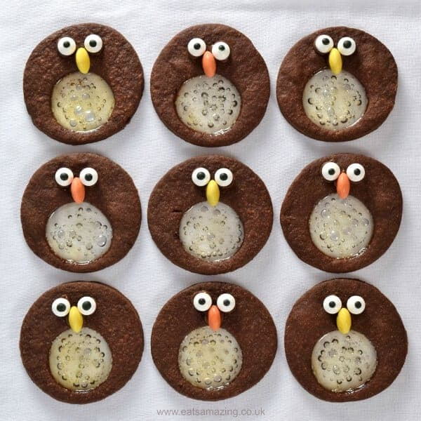 Cute and easy chocolate and mint penguin stained glass biscuits recipe - fun food idea for kids this Christmas - Eats Amazing