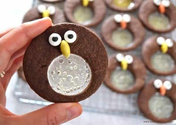 Cute and easy chocolate mint penguin stained glass cookies recipe - fun Christmas treat idea for kids - Eats Amazing