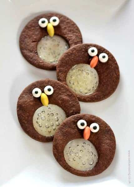 Cute chocolate mint penguin stained glass cookies recipe - fun food idea for kids this Christmas - Eats Amazing