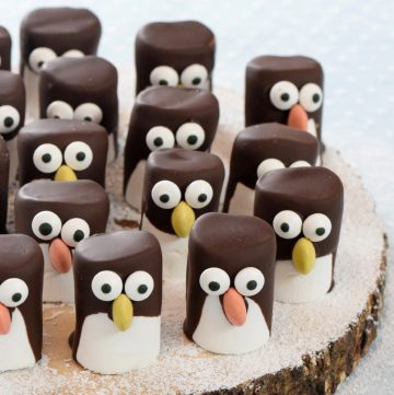 Fun and easy Marshmallow Penguins recipe - cute penguin themed food art for kids