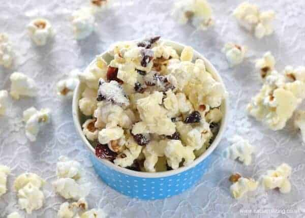 How to make Cranberry White Chocolate Popcorn - Easy treat recipe that is perfect for a family movie night - Eats Amazing UK