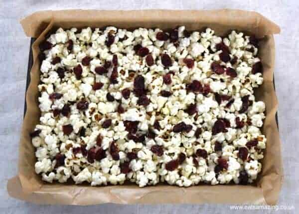 How to make Cranberry and White Chocolate Popcorn - Easy treat recipe that is perfect for a festive family movie night - Eats Amazing UK