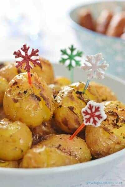 Rosemary and Garlic Crushed Potatoes recipe - a gorgeous easy party food recipe and the perfect side dish for a roast dinner too - Eats Amazing UK
