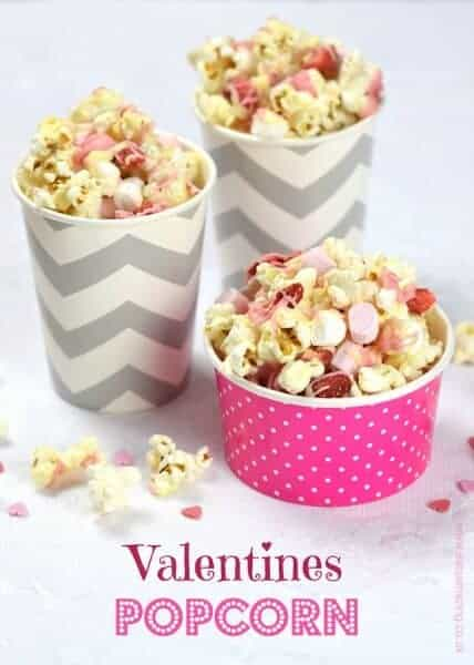 Cute and easy Valentines popcorn mix recipe with white chocolate strawberries and marshmallows - fun valentines treat for kids - Eats Amazing UK