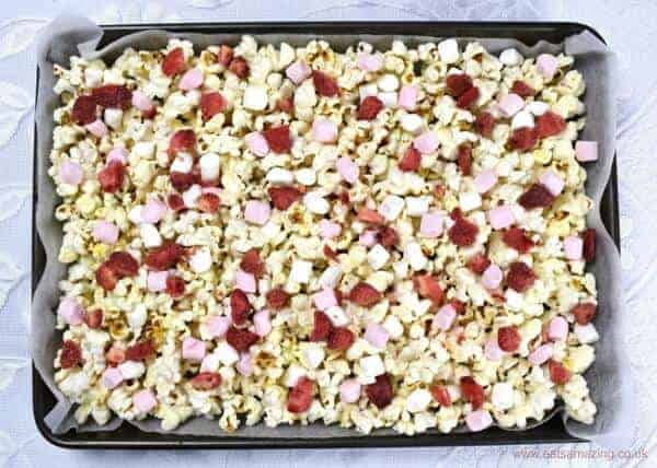 How to make white chocolate strawberries and marshmallows Valentines popcorn - fun Valentines day treat recipe that kids can make - Eats Amazing UK