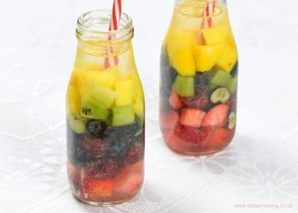 Gorgeous rainbow unicorn fruit infused water idea - a great way to get the kids drinking water this summer - Eats Amazing UK