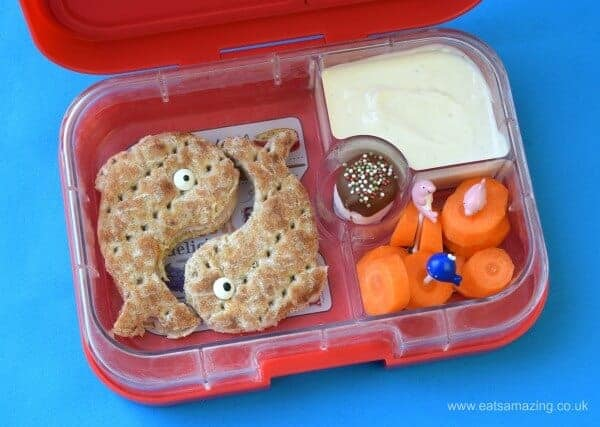 Easy ocean themed yumbox bento lunch with dolphin sandwiches made using LunchPunch Sandwich Cutters from Eats Amazing UK
