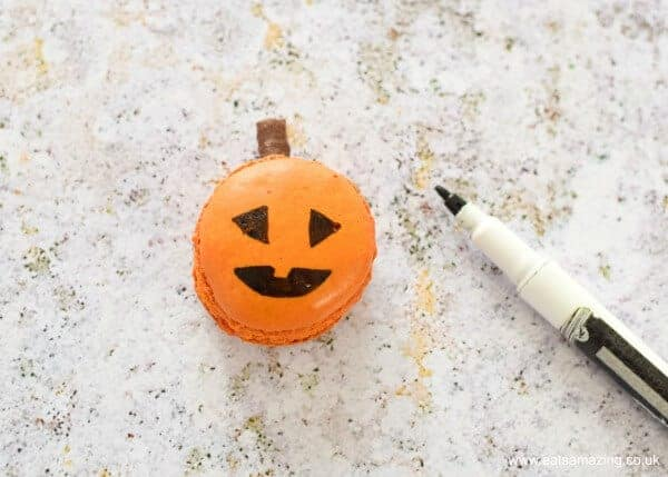 How to make Pumpkin Face Macarons - fun food idea for Halloween from Eats Amazing UK - Painted Face