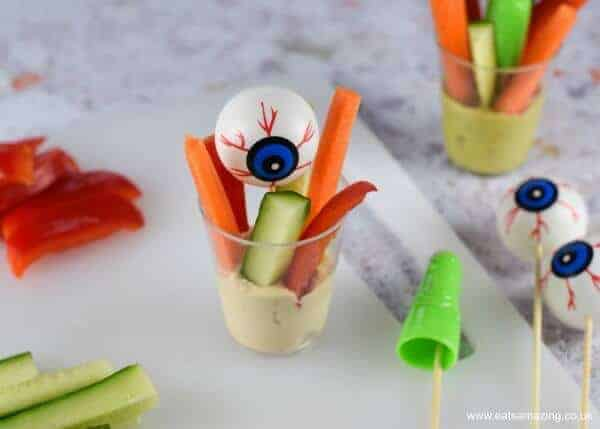 How to make creepy crudite cups - fun Halloween recipe for kids from Eats Amazing UK - Step 3 - add eyeballs and fingers
