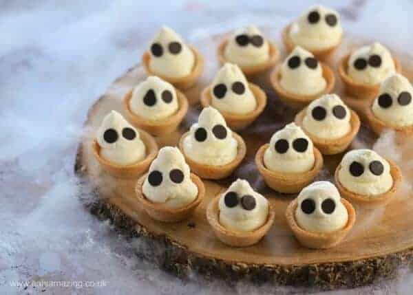 Quick and easy Halloween dessert recipe - fun Ghost mini cheesecake bites - this cute recipe is perfect for Halloween party food - Eats Amazing UK