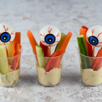 Quick and easy creepy eye Crudite Cups recipe - healthy and fun allergy friendly Halloween party food idea for kids - Eats Amazing UK