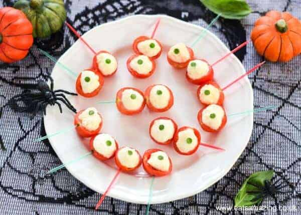 Spooky Eyeball Caprese Bites Recipe - fun easy healthy Halloween food - perfect for Halloween party food snacks and kids lunchboxes - Eats Amazing UK