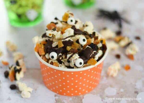 Spooky Halloween popcorn with dark chocolate - fun Halloween recipe to make with kids - great for movie snacks and party food - Eats Amazing UK
