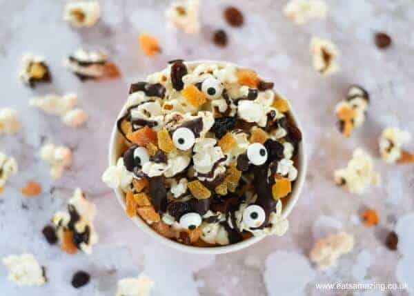 Yummy Halloween popcorn with dark chocolate - fun Halloween recipe to make with kids - great for movie snacks and party food - Eats Amazing UK