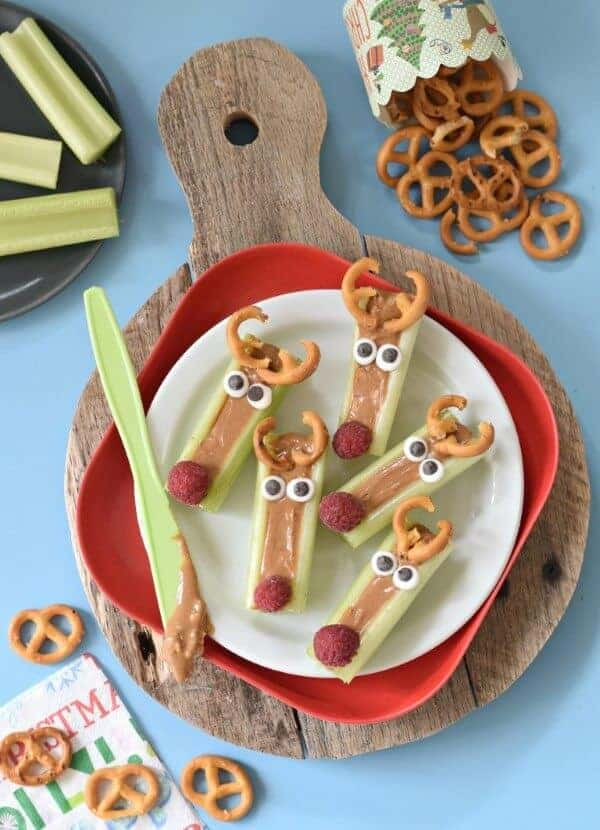 25 Fun Reindeer Themed Foods for Kids this Christmas - Peanut Butter Celery Reindeer Snack from Fork and Beans