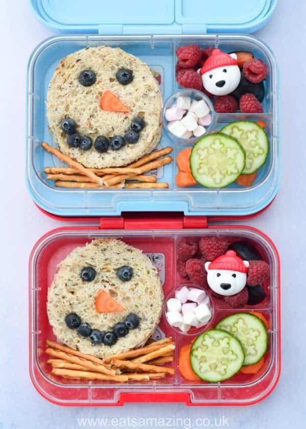 Easy snowman sandwich lunches for kids - fun and healthy Christmas packed lunch idea in the Yumbox bento box from Eats Amazing UK #bento #lunchtime #lunchideas #bentoboxlunch #yumboxlunch #kidslunch #kidsfood #healthykids #snowman #sandwich #edibleart #funfood #foodart #schoollunch