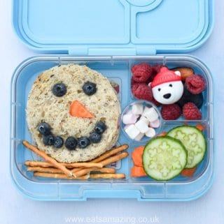 Fun and easy snowman sandwich lunch idea for kids - fun and healthy Christmas packed lunch in the Yumbox bento box from Eats Amazing UK