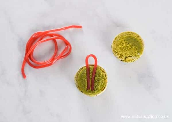How to make festive macaron baubles - a fun Christmas dessert or party food idea from Eats Amazing UK - Step 2 Add the edible string