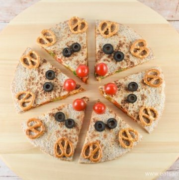 Quick and easy reindeer quesadillas - healthy fun Christmas food for kids from Eats Amazing UK - Step 7 Finish with pretzel antlers