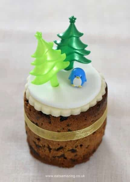 Six super easy Christmas cake designs on mini Christmas cakes - cupcake pick Christmas trees cake from Eats Amazing UK