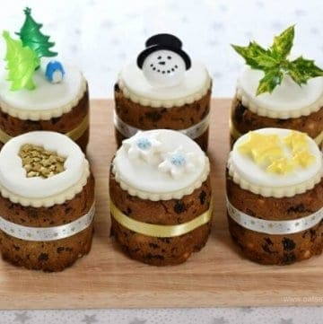 Six super easy Christmas cake designs on mini Christmas cakes made in bean tins from Eats Amazing UK