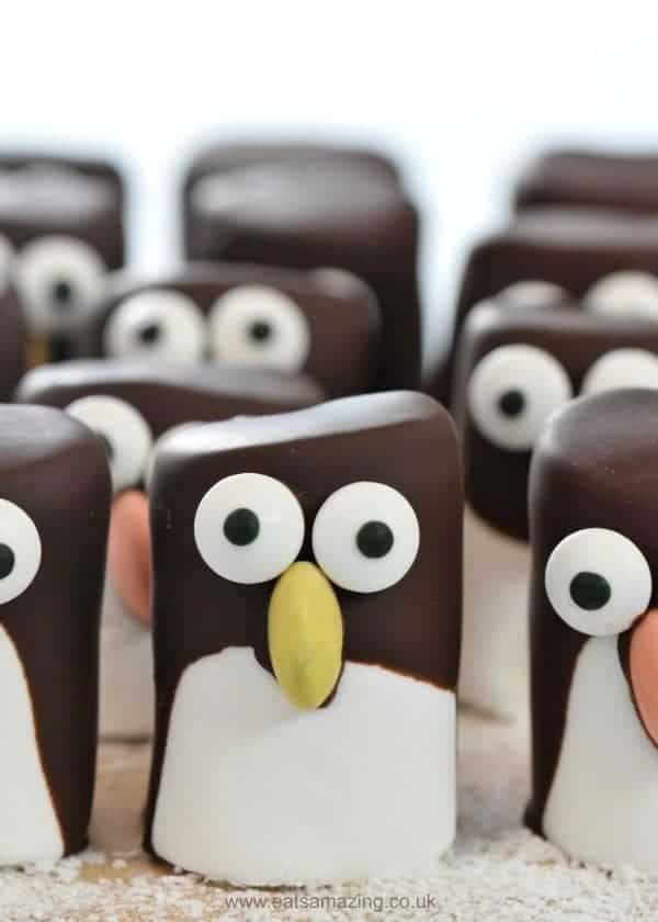 15 Fun and easy penguin themed food ideas for kids - penguin marshmallows from Eats Amazing
