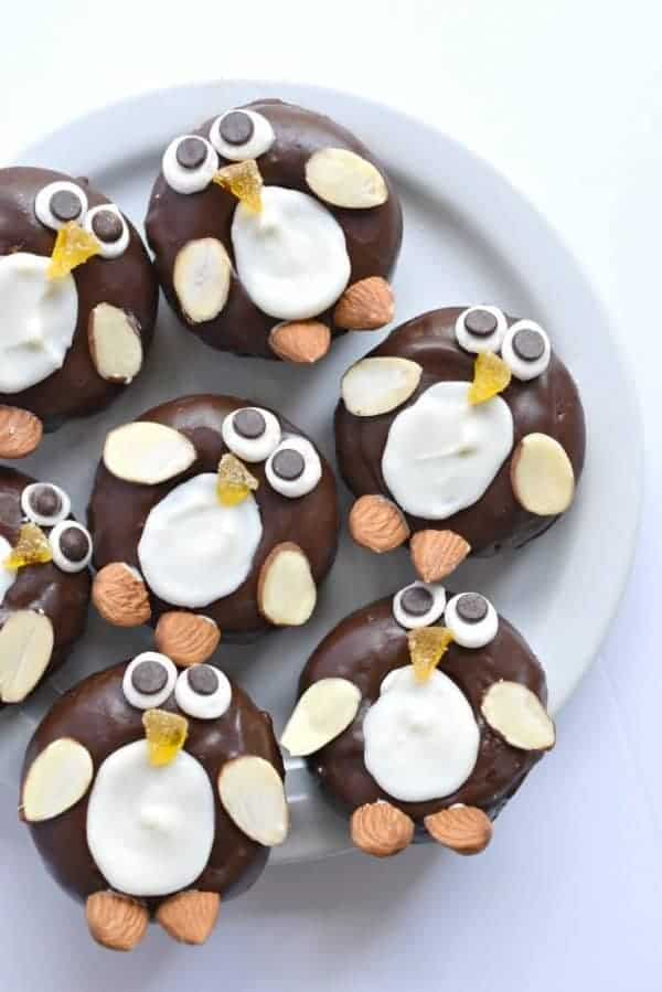 15 Fun and easy penguin themed foods for kids - Mini Chocolate Donut Penguins from Fork and Beans
