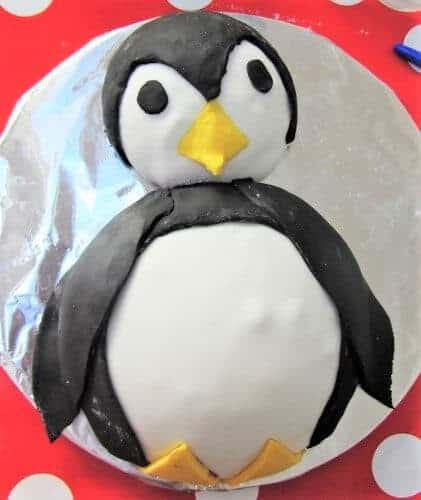 15 Fun and easy penguin themed foods for kids - Penguin Cake from Searching for Spice