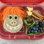 Fun Early Man themed bento lunch with Dug sandwich and edible spears - Eats Amazing UK