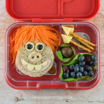 Fun Early Man themed bento lunch with Dug sandwich fruit boulders and edible spears - Eats Amazing UK