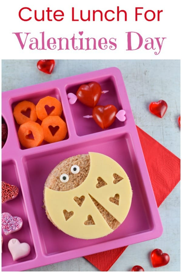 Cute Valentines Day lunch for kids with fun Love Bug sandwiches with video tutorial - fun and healthy Valentines food for kids #EatsAmazing #valentinesday #valentines #kidsfood #funfood #cutefood #foodart #edibleart #lunchideas #hearts #funlunch #bento #healthykids #lunch #sandwich #ladybug